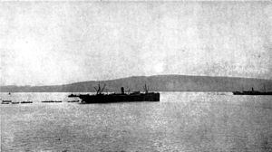 James Whiteside McCay - The sun rising over Chunuk Bair, Gallipoli peninsula, on the morning of 25 April 1915 during the landing at Anzac Cove. In the centre of the photo is SS Novian carrying the headquarters of the 2nd Infantry Brigade. At the right is the SS Galeka from which the brigade's 6th and 7th Infantry Battalions have been landing.