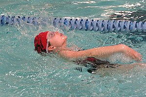 Backstroke - A swimmer focuses on the ceiling while doing the backstroke.