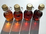 U.S. Syrup grades.  Left to right, Vermont Fancy, Grade A Medium Amber, Grade A Dark Amber, Grade B