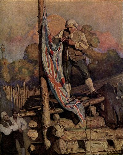 A man in a formal wig and suit, standing on the roof of a log cabin, hoists the Union Flag.