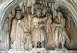 Taq-e Bostan - High-relief of Anahita, Khosro II, Ahura Mazda.jpg