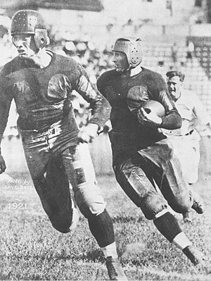 1920 Georgia Tech Golden Tornado football team - Harlan running interference for Barron.