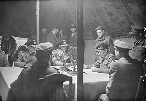 German surrender at Lüneburg Heath - Field Marshal Montgomery (seated second from the right) signs the terms of the surrender watched by Rear Admiral Wagner and Admiral von Friedeburg.