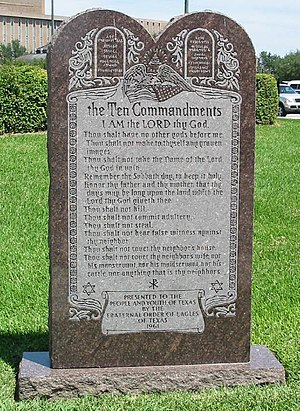 The Ten Commandments on a monument on the grou...