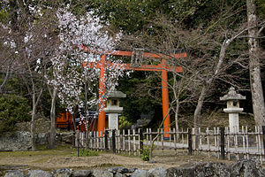 A small shrine on the grounds of the temple, w...