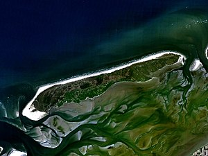 Holmes's Bonfire - Satellite image of Terschelling. The broad white beach visible at the western tip of the island, the former Noordvaarder sandbank, did not exist in the 17th century; Holmes's approach route into the Vlie today crosses solid land