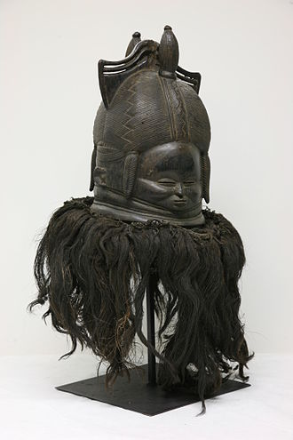 Religion in Guinea - A Sande society helmet mask (1940-1965). The Sande society is a secret women's association.