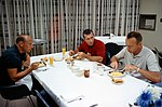 The Gemini-11 prime crew enjoys a breakfast.jpg
