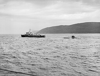 Operation Deadlight - Polish Navy destroyer ORP Krakowiak towing German Type XXIII U-boat U-2377 out to sea for scuttling on 28 November 1945