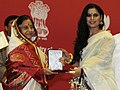 The President, Smt. Pratibha Devisingh Patil presenting the Rajat Kamal Award to Ms. Ananya Chatterjee for the Best Actress (Film Abohomaan) at the 57th National Film Awards function, in New Delhi on October 22, 2010.jpg
