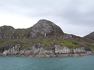 English: The statue on the headland. A religio...
