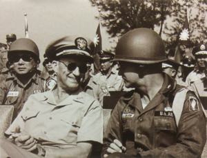Charles L. Melson - VADM Charles L. Melson (left), then Commander of the United States Taiwan Defense Command, talked with Brig. Gen. Ellis W. Williamson (right) during an airborne military exercise in Taiwan, 1963.