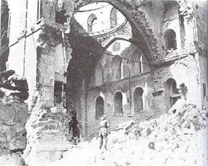 Islamization of Jerusalem - An Arab Legion soldier in ruins of Tiferet Yisrael Synagogue.