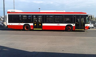 Toronto Transit Commission bus system - A Nova Bus in the 2017 livery, based on that of the Flexity Outlook streetcar