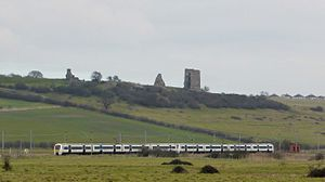 Train passing Hadleigh Castle Essex (16541671055).jpg