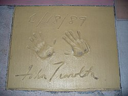 The handprints of John Travolta in front of The Great Movie Ride at Walt Disney World's Disney's Hollywood Studios theme park.
