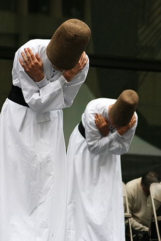 Sufi whirling - Turkish whirling dervishes of Mevlevi Order, bowing in unison during the Sema ceremony