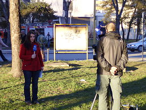 Hayat TV (Bosnia and Herzegovina) - A Hayat TV reporter outside the burning Government Building of Tuzla Canton