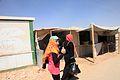 Two women walk through the Zaatari refugee camp in northern Jordan (9634884939).jpg