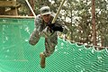 U.S. Army Sgt. Salvador Santos, with Headquarters and Headquarters Company, 18th Combat Sustainment Support Battalion negotiates a rope obstacle at the 7th Army Joint Multinational Training Command's Grafenwoehr 140904-A-BS310-363.jpg