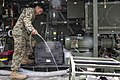 U.S. Marine Corps Cpl. Justin Ventura, a water support technician with the 9th Engineer Support Battalion, 3rd Marine Logistics Group, performs maintenance on a tactical water purification system before 140925-M-RN526-044.jpg
