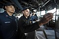 U.S. Navy Aerographer's Mate 1st Class Paul Ventura, left, looks on as Quartermaster Seaman Pasquale Verrastro explains a proposed navigational course aboard the guided missile destroyer USS Ramage (DDG 61) 131209-N-VC236-002.jpg