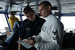 U.S. Navy Aviation Boatswain's Mate (Handling) 2nd Class Jared Whitefield, right, describes the function of primary flight control to Midshipman 1st Class Chad Wasson, a student at Norwich University 130624-N-RX668-052.jpg