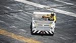 U.S. Navy Aviation Boatswain's Mate (Handling) 2nd Class Tony Fuller drives an aircraft tow tractor across the flight deck of the aircraft carrier USS Nimitz (CVN 68) Aug. 19, 2013, in the U.S. 5th Fleet 130819-N-AZ866-055.jpg