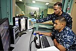 U.S. Navy Hospital Corpsman 2nd Class Daniel Gonzales, foreground, and Hospital Corpsman 1st Class Vude Rosario check the computerized tomography scan of an Indonesian man aboard Military Sealift Command 120602-O-ZZ999-018.jpg