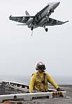 U.S. Navy Lt. Zachary Boguslawski serves as the arresting gear officer as an F-A-18C Hornet aircraft assigned to Strike Fighter Squadron (VFA) 146 prepares to land aboard the aircraft carrier USS Nimitz (CVN 68) 130619-N-GA424-088.jpg