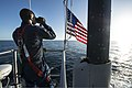 U.S. Navy Sonar Technician (Submarine) 3rd Class Jesse Delia stands lookout in the pilothouse aboard the attack submarine Pre-Commissioning Unit Minnesota (SSN 783) as the boat transits Port Canaveral, Fla 130813-N-XO436-430.jpg