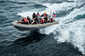 U.S. Sailors and Coast Guardsmen travel in a rigid-hull inflatable boat before boarding the guided missile destroyer USS Stockdale (DDG 106) during a visit, board, search and seizure training exercise April 26 130426-N-HN991-064.jpg