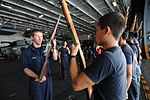 U.S. Sailors participate in honor guard tryouts in the hangar bay aboard the aircraft carrier USS Nimitz (CVN 68) June 24, 2013, in the Gulf of Oman 130624-N-BJ752-048.jpg