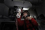 USS George Washington sailors at work 130710-N-TP877-226.jpg
