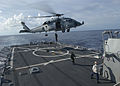 US Navy 030913-N-6187M-005 Members of Explosive Ordnance Disposal Mobile Unit Two perform a fast-roping exercise on the flight deck of the guided missile.jpg
