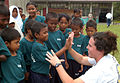 US Navy 040714-N-4104L-005 Lt. j. g. Sarah Heidt, anti-submarine warfare officer on board USS McCampbell (DDG 85), teaches Aboriginal students at their school how to give a high five.jpg