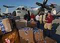 US Navy 050113-N-4308O-095 Postal Clerk 3rd Class Jonathan Moody, helps unload mail and cargo from a C-2 Greyhound.jpg