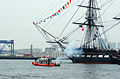 US Navy 050611-C-4938N-324 U.S. Coast Guard patrol boats and a tugboat escort USS Constitution, Old Ironsides, out to Island Castle Hill in south Boston prior to firing a 21-gun salute.jpg