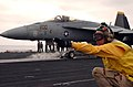 US Navy 051107-N-5549O-123 Commanding Officer, USS Ronald Reagan (CVN 76), Capt. James A. Symonds, gives the signal to launch an F-A-18E Super Hornet.jpg