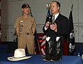 US Navy 051221-N-2532P-030 Executive Director of the Ronald Reagan Presidential Library, Duke Blackwood, right, explains the history of a pair of boots and cowboy hat worn by President Ronald Reagan.jpg