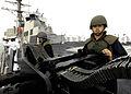 US Navy 060410-N-7981E-042 Gunner's Mate Seaman Ernest Quinones mans an M2HB twin .50 Caliber Machine Gun.jpg