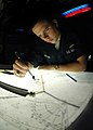 US Navy 060422-N-4015L-021 Aviation Warfare Systems Operator Airman Jonathan Norrod plots ship positions and submarine tracks on a tactical plotting station.jpg