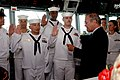 US Navy 060604-N-0696M-209 Secretary of Defense Donald H. Rumsfeld reenlists four Sailors on the bridge of the Arliegh Burke-class guided missile destroyer USS McCampbell (DDG 85).jpg