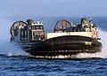 US Navy 070209-N-6710M-003 A Landing Craft Air Cushion (LCAC) prepares to enter the well deck of dock landing ship USS Tortuga (LSD 46) after an offload of Marine equipment in the vicinity of Okinawa, Japan.jpg