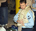 US Navy 070304-N-4034B-004 Aviation Structural Mechanic 2nd Class Robert Larson tries on a protective vest during pre-deployment outfitting.jpg