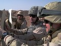 US Navy 070419-N-8275M-009 Yeoman 1st Class Mark Calcaterra helps Lt. Peter Simmons fasten a target to a post at the Camp Fallujah weapon's range.jpg