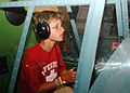US Navy 070619-N-9758L-102 Nathaniel Allen enjoys a simulated flight of the Battle of Guadalcanal at the Pacific Aviation Museum, located on Ford Island, during a private tour sponsored by the Make-A-Wish Foundation.jpg
