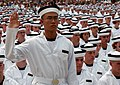 US Navy 070627-N-0593C-006 Midshipman 4th Class Daniel Chan from Singapore takes the Oath of Compliance at the U.S. Naval Academy Class of 2011 Induction Day.jpg