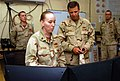 US Navy 070806-N-8275M-106 Rear Adm. Richard Cellon, commander 1st Naval Construction Division, receives a brief from Builder 1st Class Katarina Stran of the 30th Naval Construction Regiment (30 NCR) in the Combat Operations ce.jpg