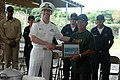 US Navy 071127-N-8433N-001 Cmdr. Steve Okun, left, executive officer of the guided-missile cruiser USS Port Royal (CG 73), presents Mangilao Mayor Nito Blas a command cap, coin and a photograph of the ship at the Mangilao Mayor.jpg
